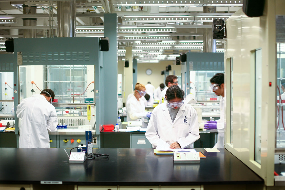 Photo of students doing research in a lab