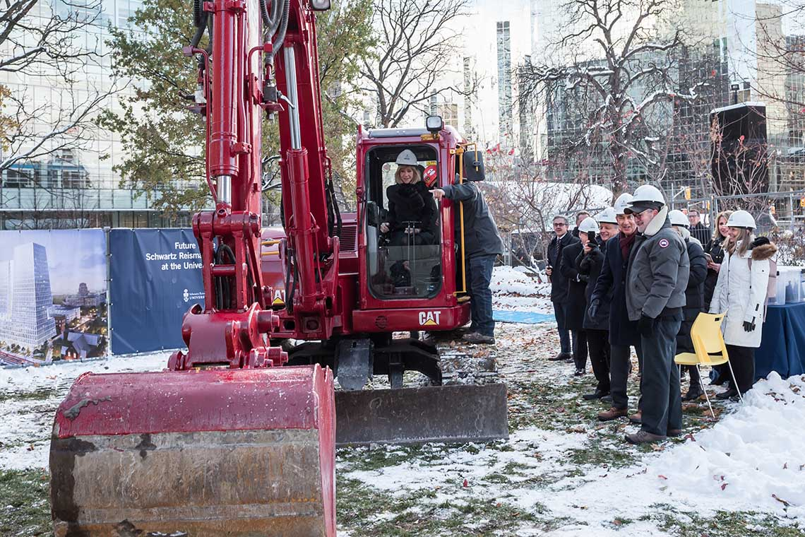 Heather Reisman operating a back hoe during the groundbreaking of the reisman schwartz innovation centre