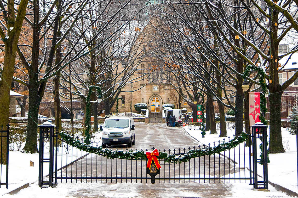 a photo of a holiday decoration adoring gates on the St. George campus