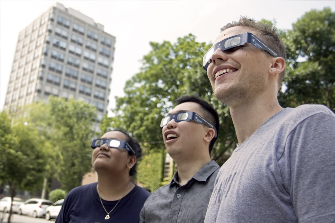 photo of students wearing eclipse glasses