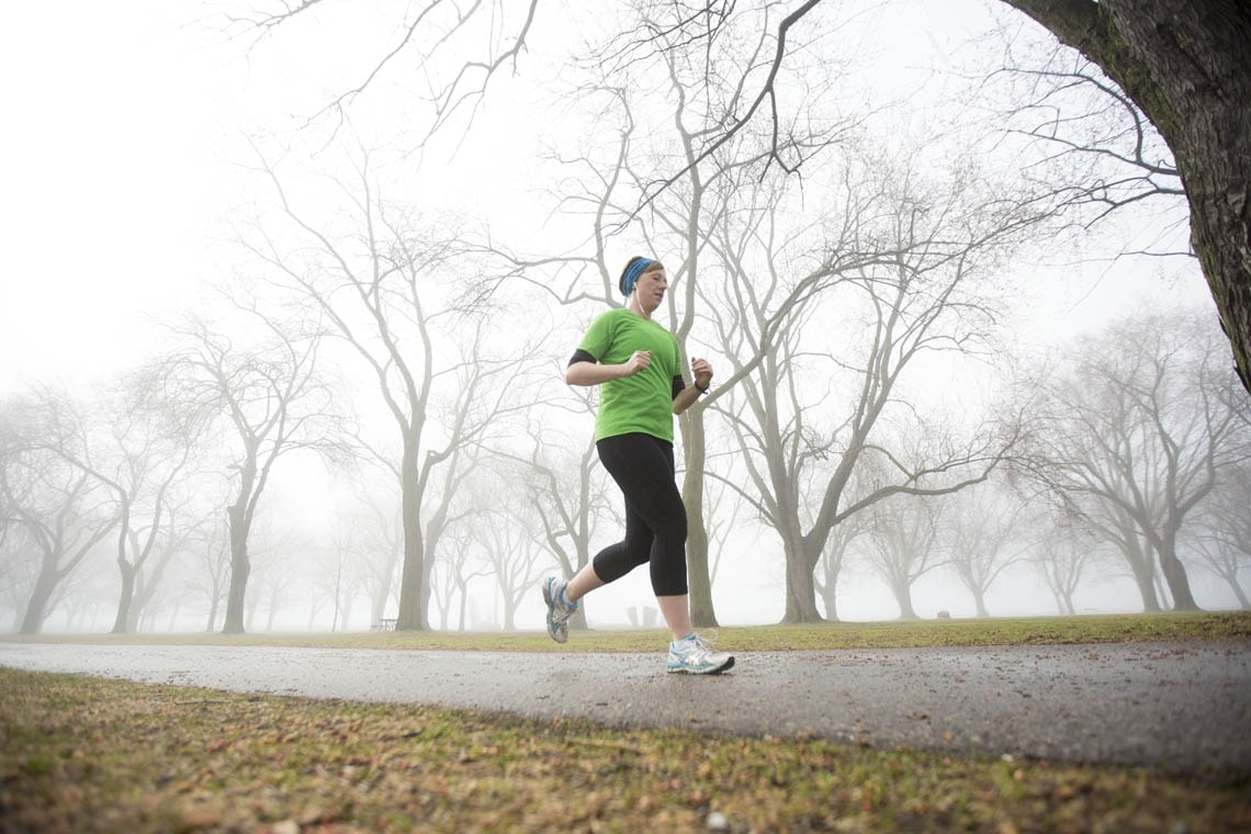 Woman jogging on a foggy morning
