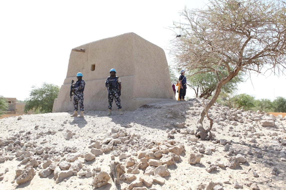 UN peacekeepers stand guard outside a restored mausoleum in Timbuktu