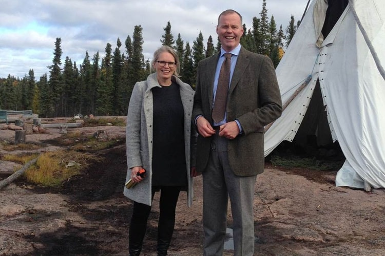 Susan Chatwood with Dalla Lana associate professor Adalsteinn Brown in the Northwest Territories in 2014