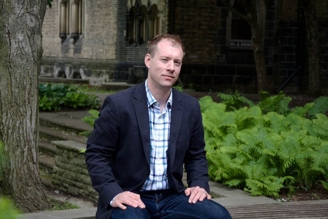 Markus Schafer on a bench at the University of Toronto