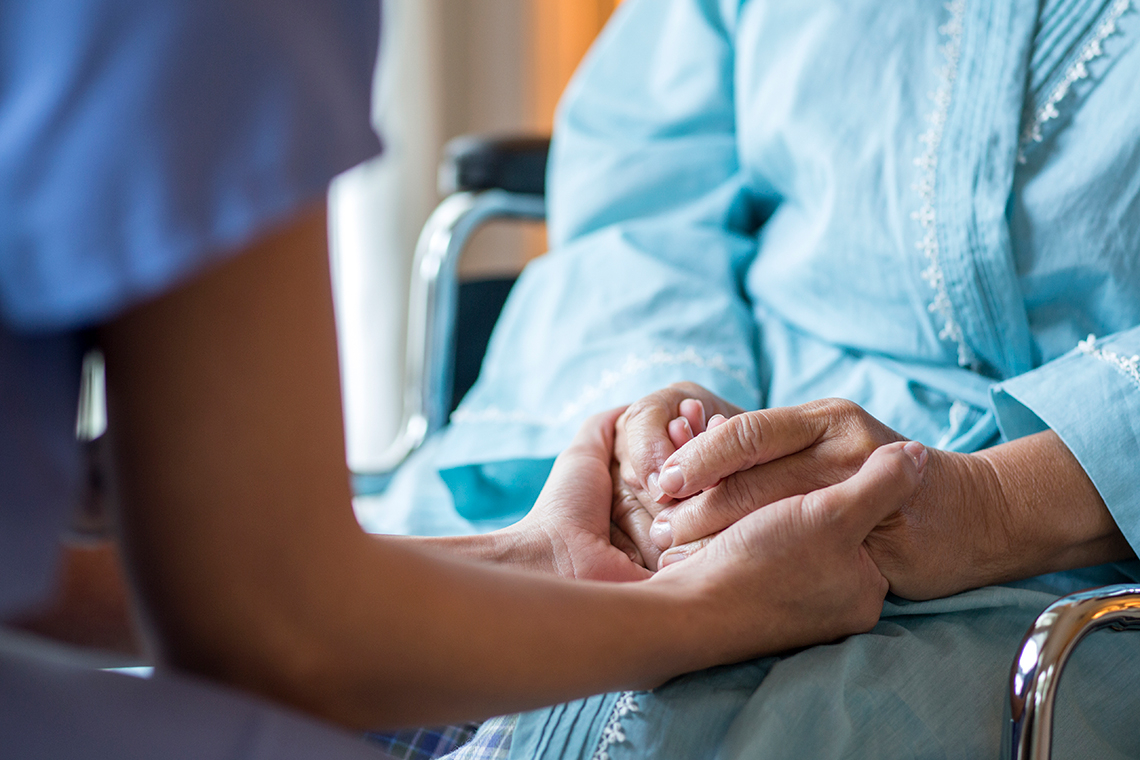 Picture illustration of nurse holding patient's hands