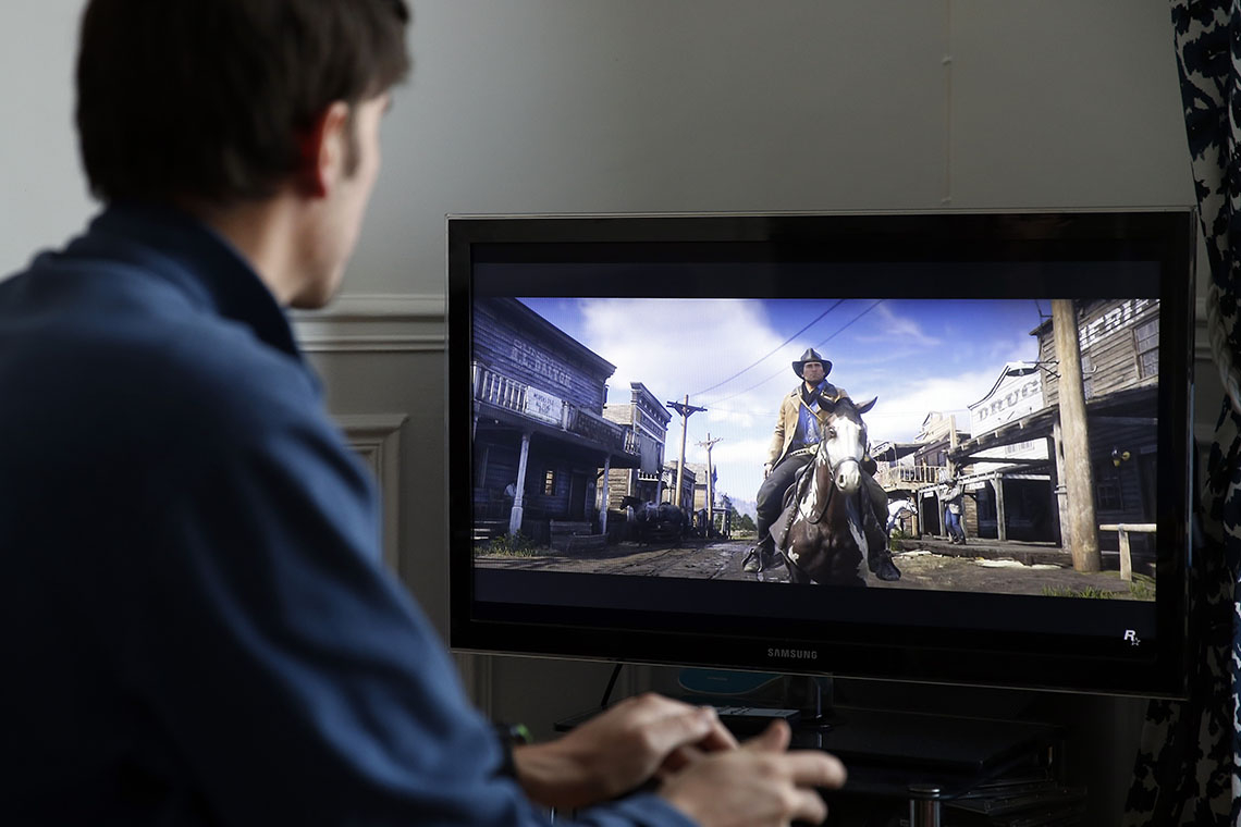 Photo of person playing a video game