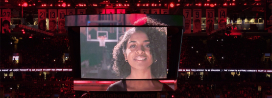 an image of hannah flores is shown on the big screen at scotiabank centre during the raptors home opener