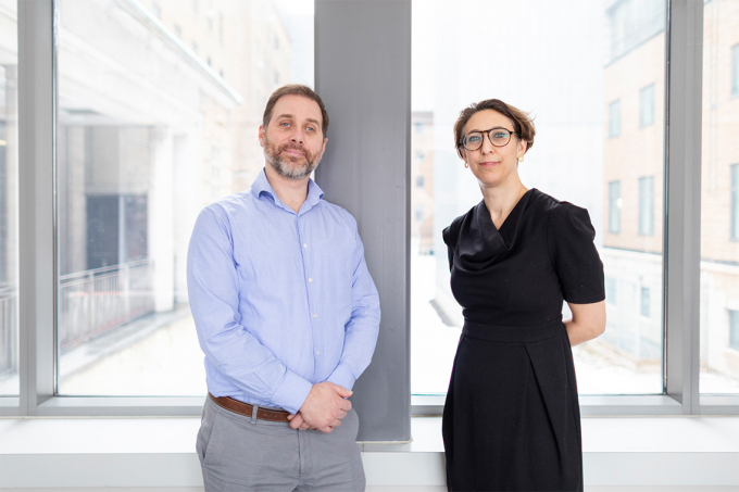 Photo of Robert Kozak and Samira Mubareka standing in front of a window