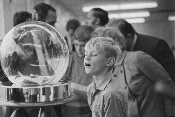 photo of boy looking at lunar samples
