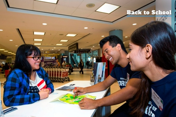 Students at U of T welcome booth at Pearson answer questions for new international students