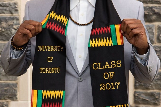 U of T grad shows off a scarf his sister gave him as a grad gift