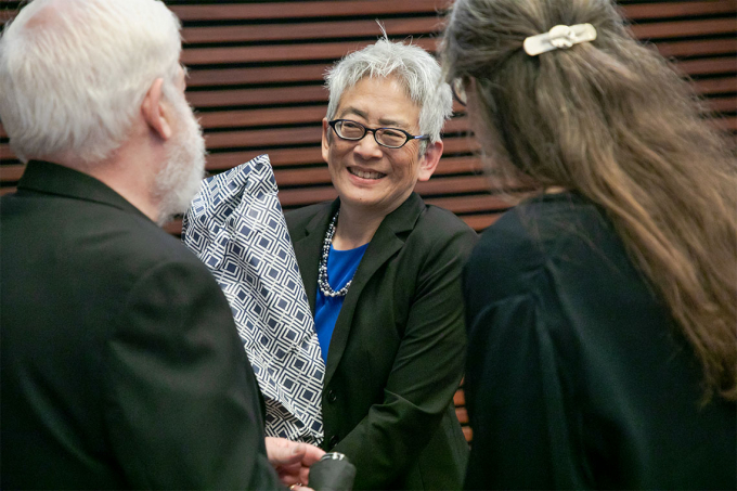 Carol Chin holding a bouquet of flowers following her installation ceremony