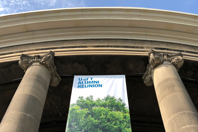Photo of alumni reunion banner hanging from Convocation Hall