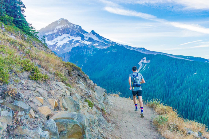 Photo of jogger on a mountain path