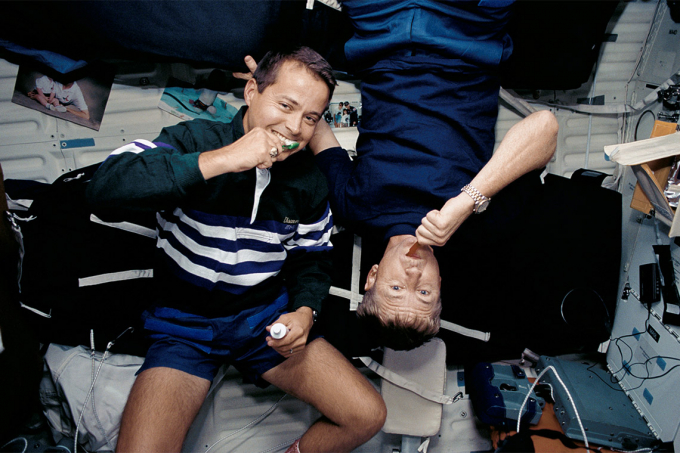 Astronauts brushing their teeth on the Space Shuttle Discovery