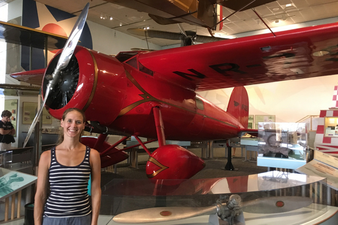 Lindsay Zier-Vogel stands in front of Amelia Earhart's plane at the Smithsonian