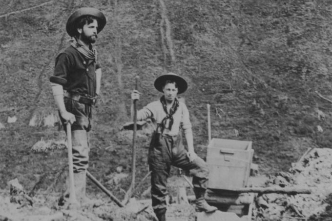 Two miners looking for gold in the yukon. Circa 1935