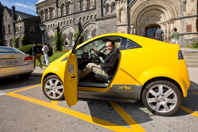 Photo of Olivier Trescases sitting in an electric car