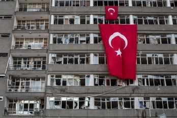 Turkey's flag draped over an abandoned building