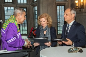 photo of elder with provost and president