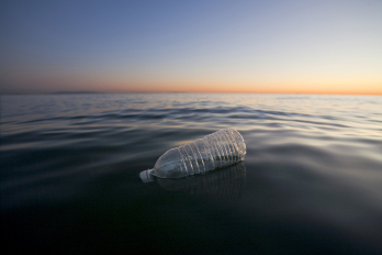 photo of plastic bottle in ocean