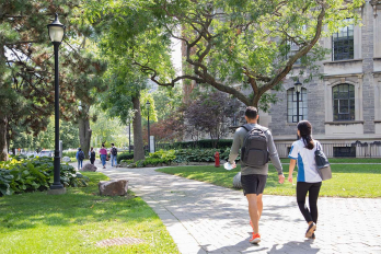 students walking past the David Naylor Building at St. George Campus, University of Toronto