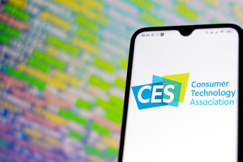 A cell phone displays the logo for the consumer electronics show