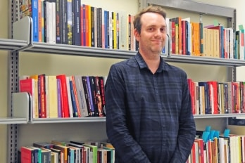 Copyright outreach librarian Graeme Slaght helps professors digitize their course material. (Photo by Romi Levine)