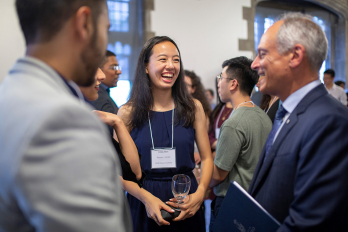 Pearson Scholar laughing with Meric Gertler