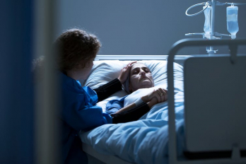 Photo of patient in hospital bed